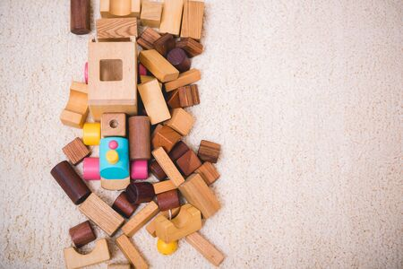 Building playing toy blocks wood for baby education with copy space