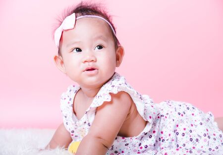 Asian girl cute baby smiling face on pink background