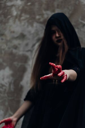 Portrait woman ghost devil and reach out hand have red blood, halloween concept Standard-Bild