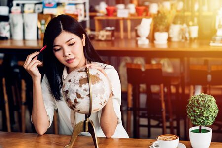 Lifestyle freelance woman he has travel planning after end work in coffee shop