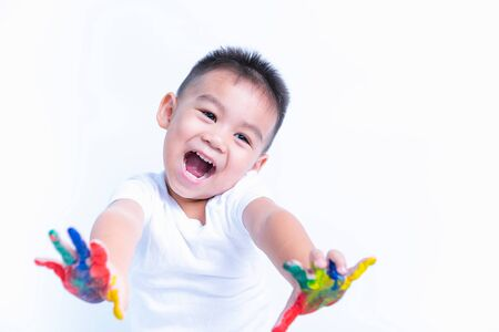 Asian portrait little baby boy show hand he have water color or finger paint on hands the photogarphy in studio on with background, Baby 2-3 years Stock Photo