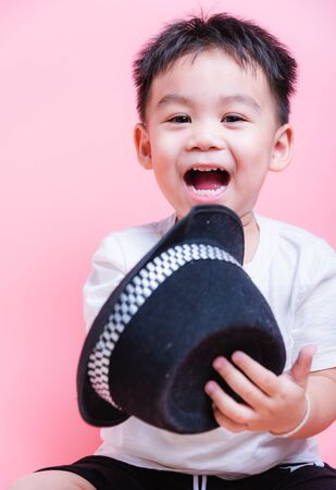 Asian boy child kid portrait he smile in studio on pink background, kid 2 years
