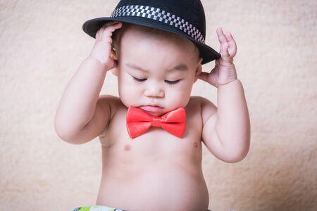 Little boy children portrait in red bow tie.