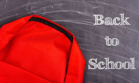 Back to school shopping pocket backpack on the education red bag on blackboard and chalkboard