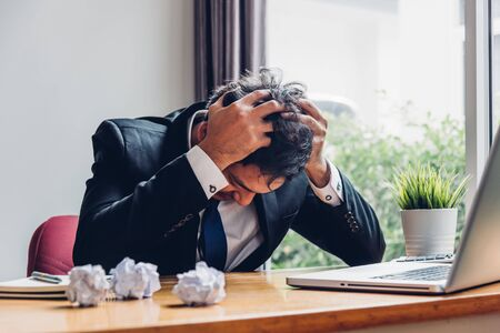 Asian young business man tired strain failure on he work in desk table office Stockfoto