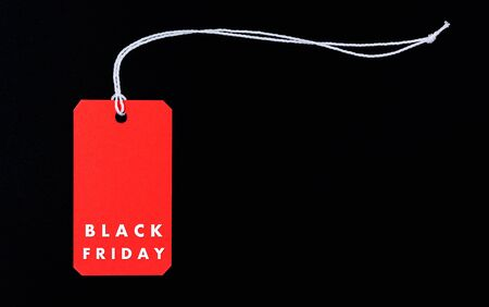 Online shopping, Promotion Black Friday text on red tag label on black background