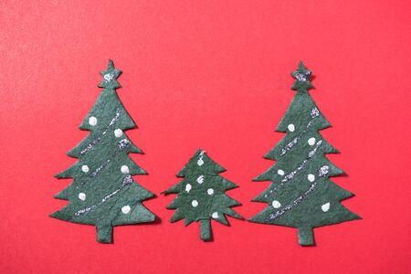 Christmas green tree on red background and have copy space for use