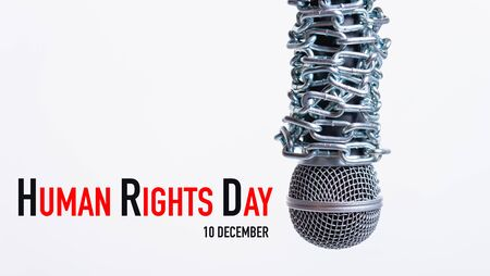 Chain on microphone with HUMAN RIGHTS DAY 10 december text on white background, Human rights day concept