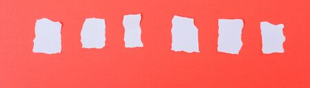 White paper torn into words on a red background Stockfoto - 133818765