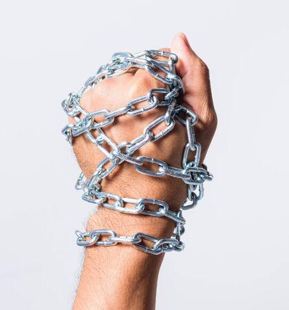 Chained fist hands on white background, Human rights day concept