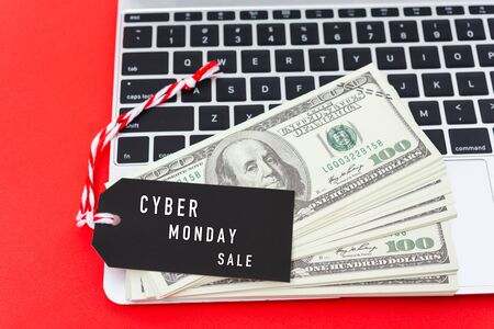 Online shopping CYBER MONDAY sale text on Black tag label on laptop computer, with copy space