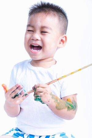 Happy asian little baby childhood playing use paintbrush draw watercolor or fingerpaint on finger by oneself, Baby 2-3 years