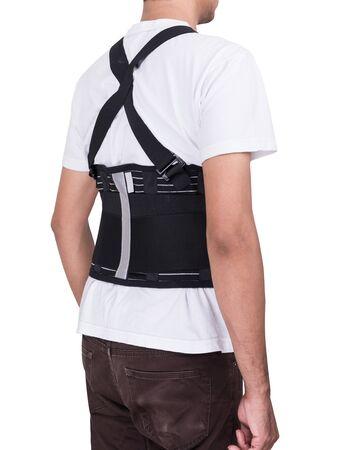 Arbeidersmens die rugsteunriem dragen om lichaam te beschermen dat op witte achtergrond wordt geïsoleerd Stockfoto