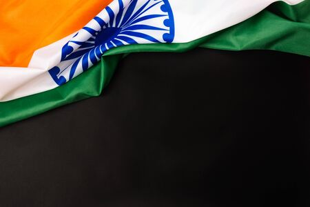 Indian republic day, flat lay top view, Indian flag on black background with copy space for your text