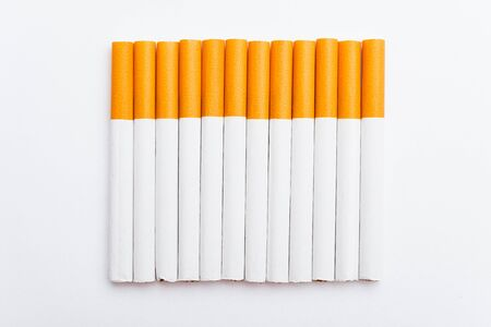 31 May of World No Tobacco Day, no smoking, close up of lined up full pile cigarette or tobacco on white background with copy space, and Warning lung health concept