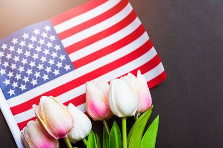 Happy Memorial Day Remember previously but now seldom called Decoration Day, American flag and a Tulip flower on a black background and copy space, a federal holiday in the United States Standard-Bild