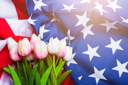 Happy Memorial Day Remember previously but now seldom called Decoration Day, American flag and a Tulip flower on a black background and copy space, a federal holiday in the United States Reklamní fotografie