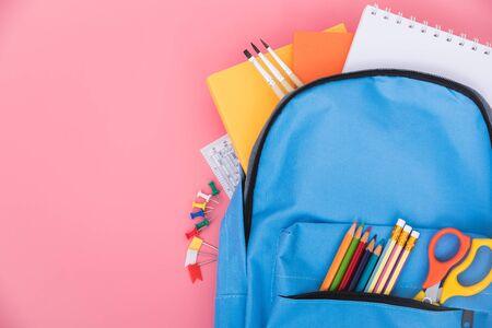 Blue bag backpack for education children on pink background back to school concept