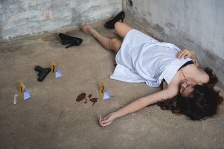 Body young woman girl dead was thief violence raped and killed on floor ground at abandon house