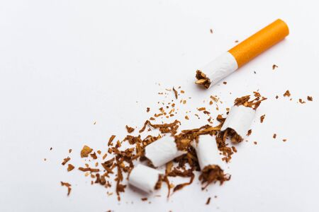 31 May of World No Tobacco Day, no smoking, close up of broken pile cigarette or tobacco STOP symbolic on white background with copy space, and Warning lung health concept