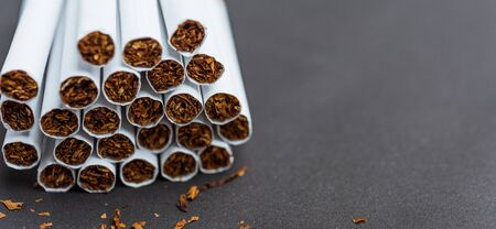 31 May of World No Tobacco Day, Close up front stack pile cigarette or tobacco on black background with copy space, Warning lung health concept Banque d'images
