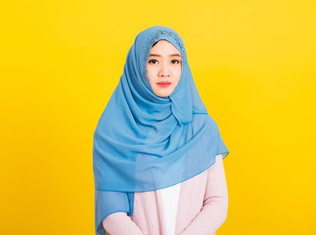 Asian Muslim Arab, Portrait of happy beautiful young woman religious wear veil hijab smiling studio shot isolated, yellow background with copy space, Close up skin face