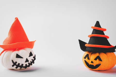 Funny Halloween day party concept ghost pumpkin head jack lantern scary smile wear hat, studio shot isolated on white background, Holiday decoration Stock Photo