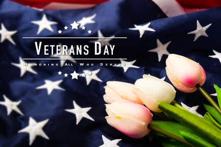 America United States flag and tulip flower, memorial remembrance and thank you of hero, studio shot with copy space background, USA holiday Veterans or Independence day concept