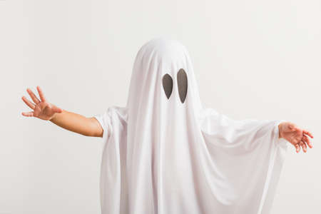 Funny Halloween Kid Concept, little cute child with white dressed costume halloween ghost scary, studio shot isolated on white background Stockfoto
