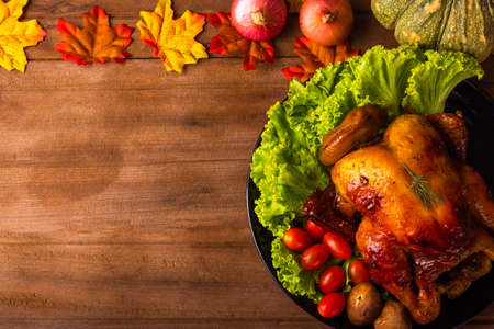 Thanksgiving baked turkey or chicken and vegetables, Christmas dinner feast food decoration, studio shot on wooden table background, Happy thanksgiving day of holiday concept