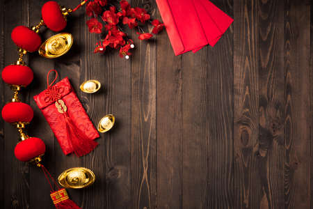 "Chinese new year 2021 festival, Top view flat lay lunar new year or Happy Chinese new year decorations celebration with copy space on the wood background (Chinese character ""fu"" meaning fortune)"
