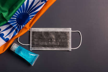 Medical protective disposable face mask for cover mouth with India flag, studio shot on gray background, Safety healthcare medical prevent coronavirus or Covid-19