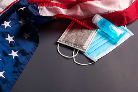 Medical protective disposable face mask for cover mouth and America flag, studio shot on gray background, Safety healthcare medical prevent coronavirus or Covid-19