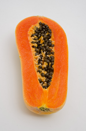 grope: papaya on white background