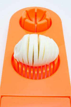 slicer: egg slicer on white background Stock Photo