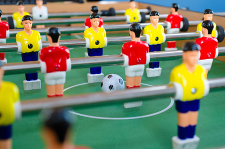 table footTable football game with yellow and red playersball
