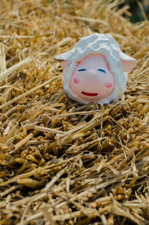 hay: clay sheep on hay Stock Photo