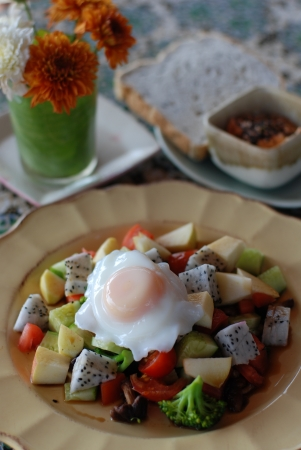 Sunny side up and fruit salad