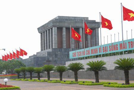 Hanoi, Vietnam - April 30, 2010   Ho Chi Minh Mausoleum with Vietnam Flags in the 35th anniversary of the Fall of Saigon and the end of the Vietnam War  Editorial