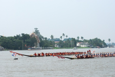 Nonthaburi,Thailand - November 6, 2010 : Long Boat Racing for the King?s Cup, with a crew of 30 paddlers on each boat.