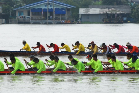 Nonthaburi,Thailand - November 6, 2010 : Long Boat Racing for the King?s Cup, with a crew of 30 paddlers on each boat. Editorial
