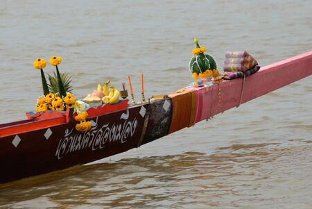 Nonthaburi,Thailand - November 6, 2010   Thai traditional  sacrificial offering for Longboat racing