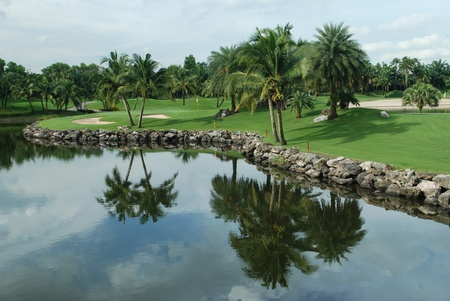 Golf course in Thailand,shot over the water toward the green
