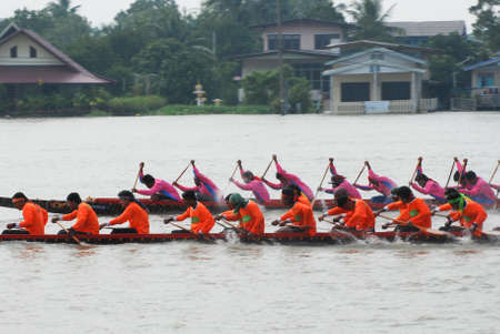 Nonthaburi,Thailand - November 6, 2010 : Long Boat Racing for the Kings Cup, with a crew of 30 paddlers on each boat.