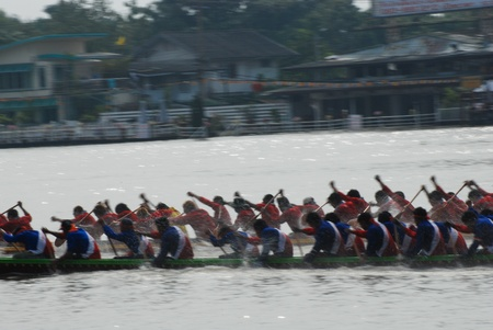 Nonthaburi,Thailand - November 6, 2010 : Long Boat Racing for the Kings Cup, with a crew of 30 paddlers on each boat. Editorial