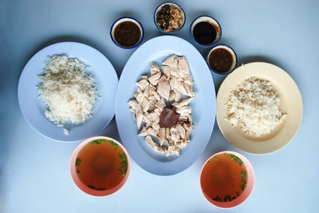 The famous Asian style food, Hainan chicken rice  boned, sliced Hainan-style chicken with marinated rice photo