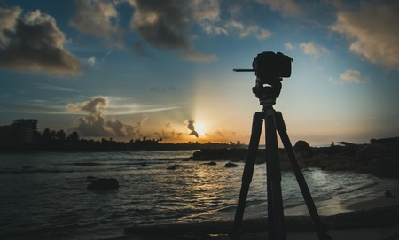 photgraphy: Camera standing on tripod at sunrise, caribbean sea, landscape, Haity