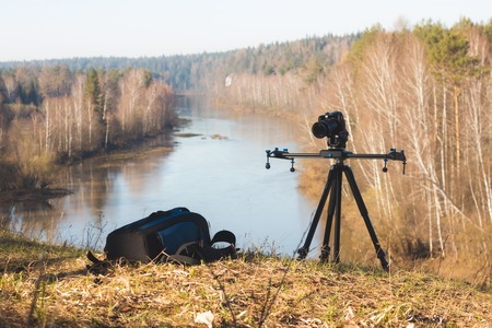 photgraphy: Camera standing on tripod at morning on forest river landscape, spring in Ural, wide angle
