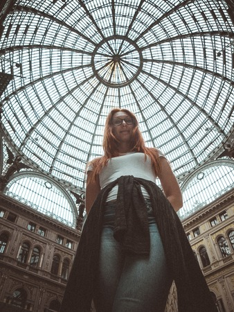 moll: Pretty young red hair woman posing in moll, Galleria Umberto I, Napoli, Roma, the view from the bottom up Stock Photo