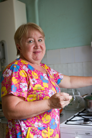 residental care: Senior woman on the kitchen At Home, family concept Stock Photo